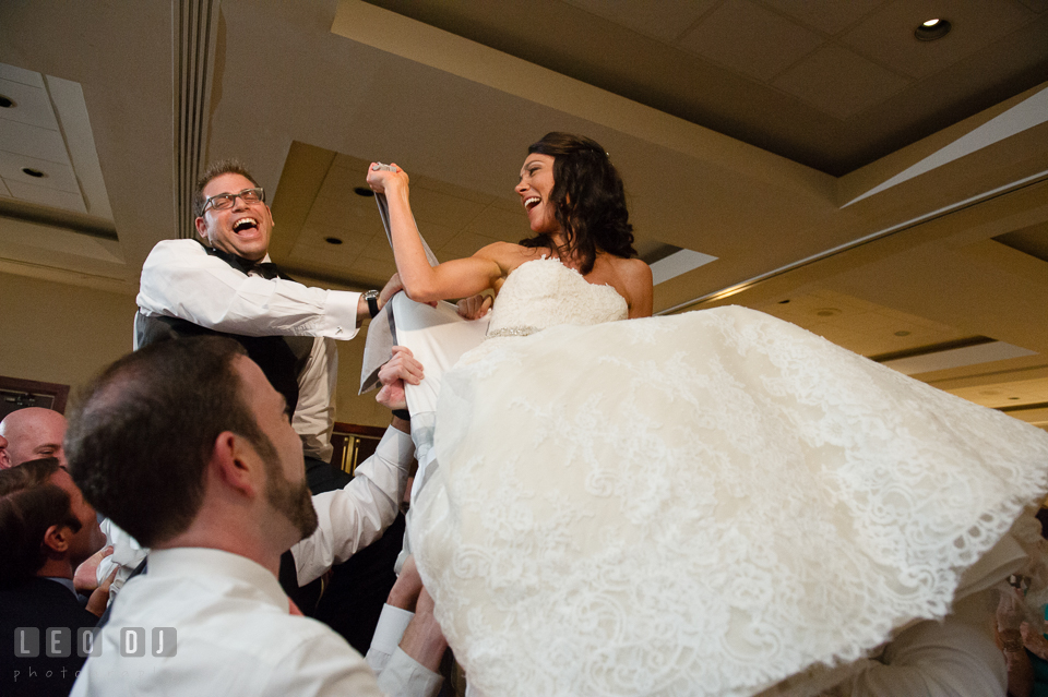 Bride and Groom raised up during Hora dance. Loews Annapolis Hotel Maryland wedding, by wedding photographers of Leo Dj Photography. http://leodjphoto.com