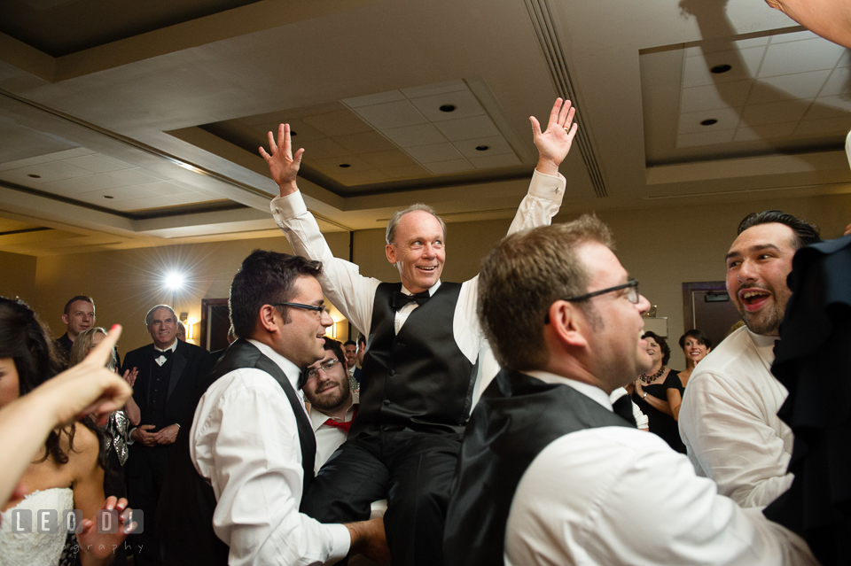 Father of Bride raised hands during Hora dance. Loews Annapolis Hotel Maryland wedding, by wedding photographers of Leo Dj Photography. http://leodjphoto.com