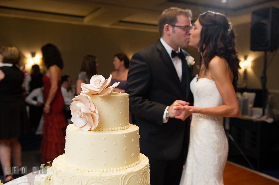 Bride and Groom kissing after the cake cutting. Loews Annapolis Hotel Maryland wedding, by wedding photographers of Leo Dj Photography. http://leodjphoto.com