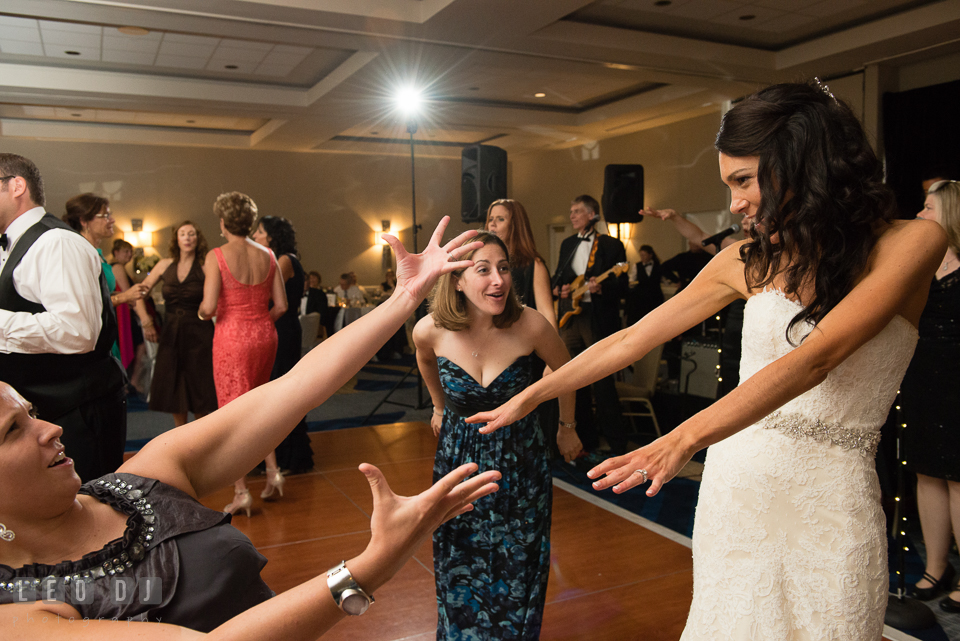 Bride and guests doing silly dances. Loews Annapolis Hotel Maryland wedding, by wedding photographers of Leo Dj Photography. http://leodjphoto.com