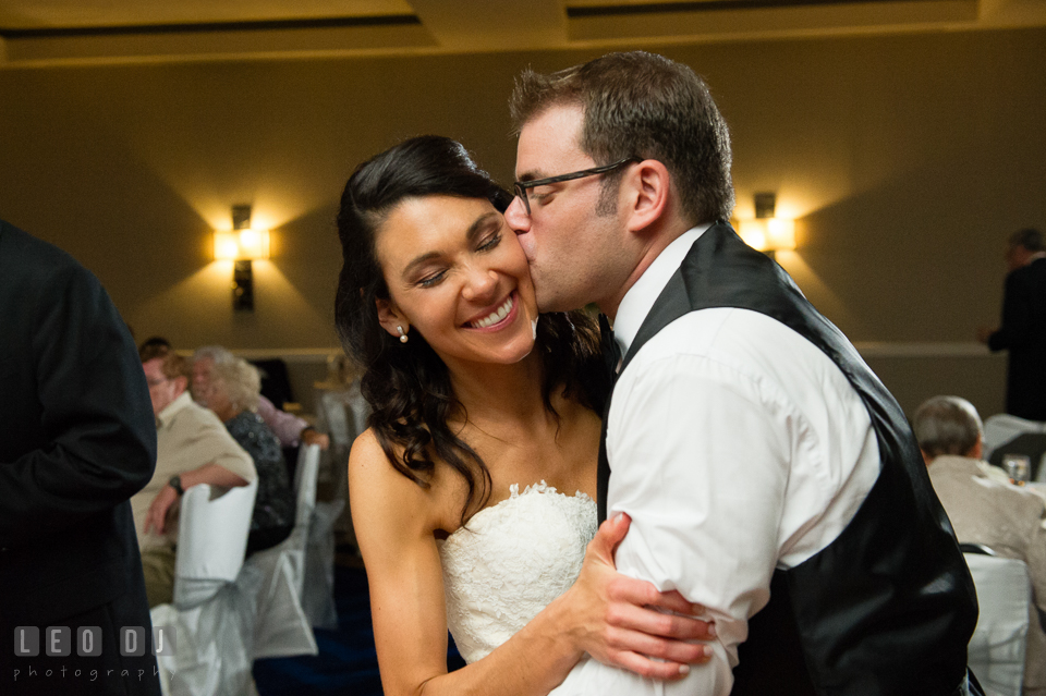 Groom kissing Bride passionately during open dance. Loews Annapolis Hotel Maryland wedding, by wedding photographers of Leo Dj Photography. http://leodjphoto.com