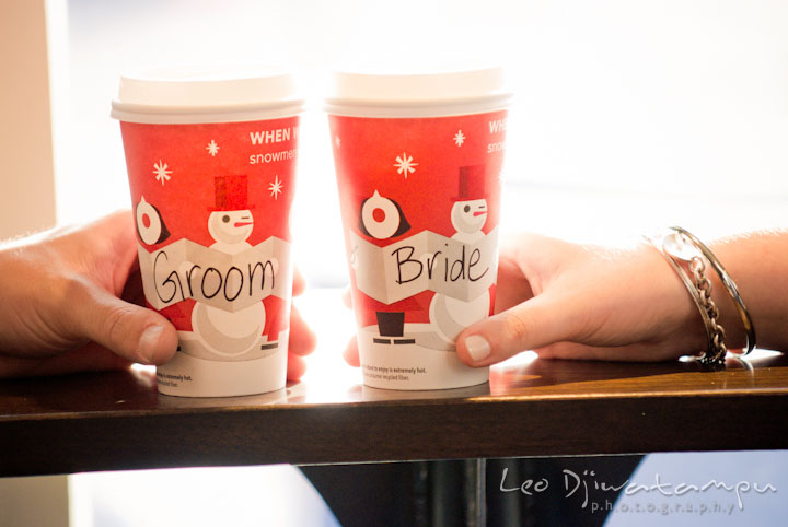 Starbuck coffee cups with bride and groom inscription. Pre-wedding or engagement photo session at Annapolis city harbor, Maryland, Eastern Shore, by wedding photographers of Leo Dj Photography.