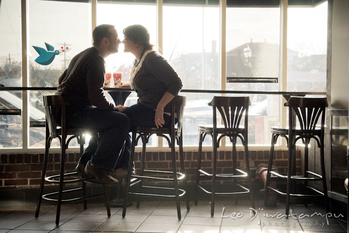 Engaged couple almost kissed inside Starbucks coffee shop. Pre-wedding or engagement photo session at Annapolis city harbor, Maryland, Eastern Shore, by wedding photographers of Leo Dj Photography.