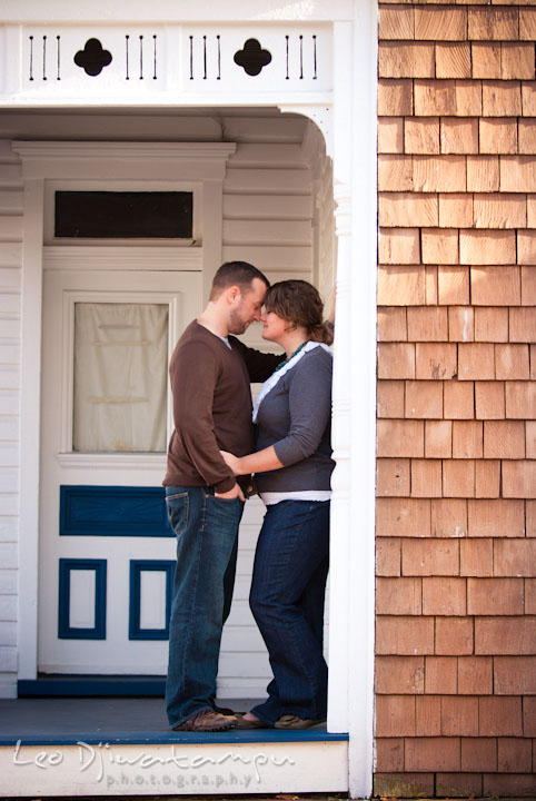 Engaged guy cuddling with his fiancee. Pre-wedding or engagement photo session at Annapolis city harbor, Maryland, Eastern Shore, by wedding photographers of Leo Dj Photography.