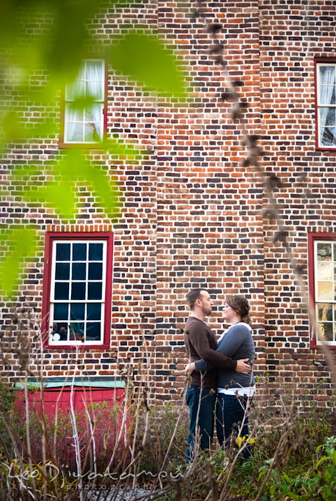 Engaged guy holding his fiancee. Pre-wedding or engagement photo session at Annapolis city harbor, Maryland, Eastern Shore, by wedding photographers of Leo Dj Photography.