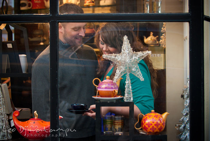 Engaged guy and girl browsing Christmas ornaments. Pre-wedding or engagement photo session at Annapolis city harbor, Maryland, Eastern Shore, by wedding photographers of Leo Dj Photography.