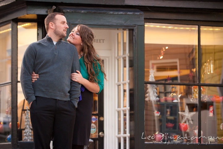 Engaged guy and his fiancee in front of a tea shop. Pre-wedding or engagement photo session at Annapolis city harbor, Maryland, Eastern Shore, by wedding photographers of Leo Dj Photography.