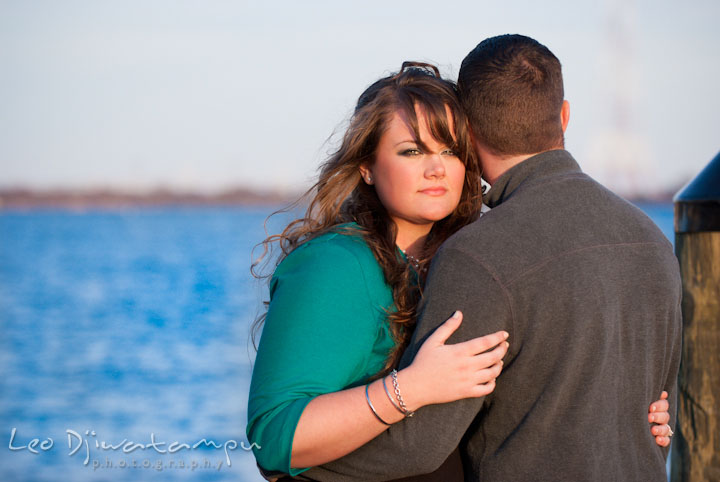 Engaged girl hugging her fiance. Pre-wedding or engagement photo session at Annapolis city harbor, Maryland, Eastern Shore, by wedding photographers of Leo Dj Photography.