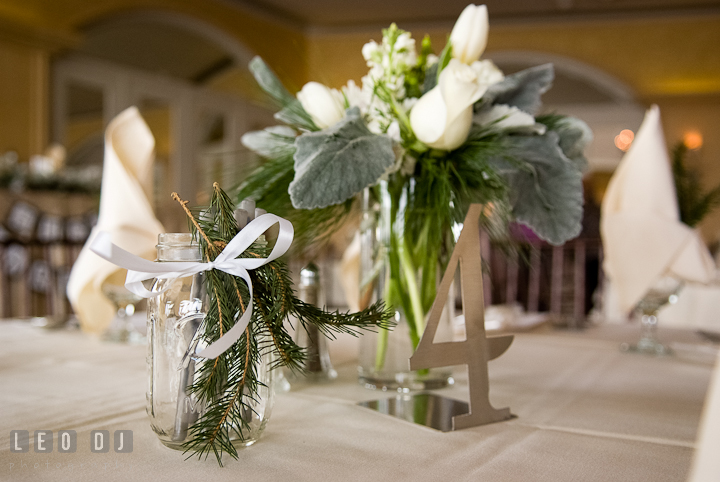 Table decorations and custom made metal table number. The Ballroom at The Chesapeake Inn wedding ceremony photos, Chesapeake City, Maryland by photographers of Leo Dj Photography.