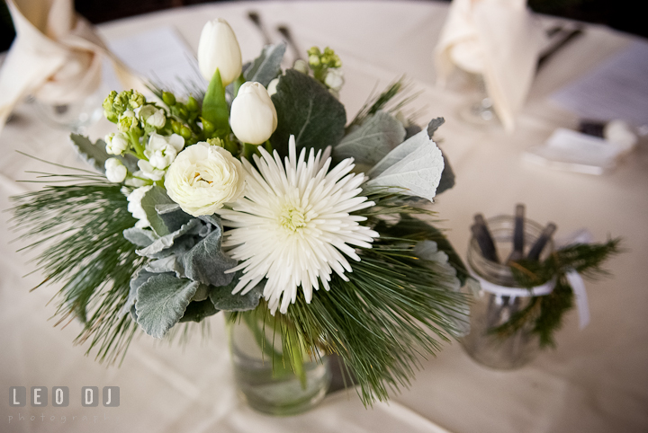 Floral table centerpiece with white rose and tulip. The Ballroom at The Chesapeake Inn wedding ceremony photos, Chesapeake City, Maryland by photographers of Leo Dj Photography.
