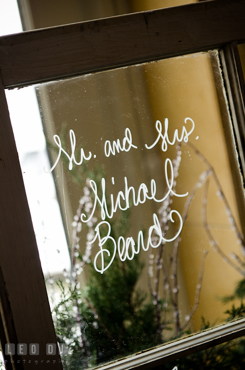 Bride and Groom's name on window glass. The Ballroom at The Chesapeake Inn wedding ceremony photos, Chesapeake City, Maryland by photographers of Leo Dj Photography.