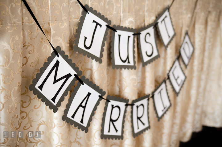 Just married banner. The Ballroom at The Chesapeake Inn wedding ceremony photos, Chesapeake City, Maryland by photographers of Leo Dj Photography.