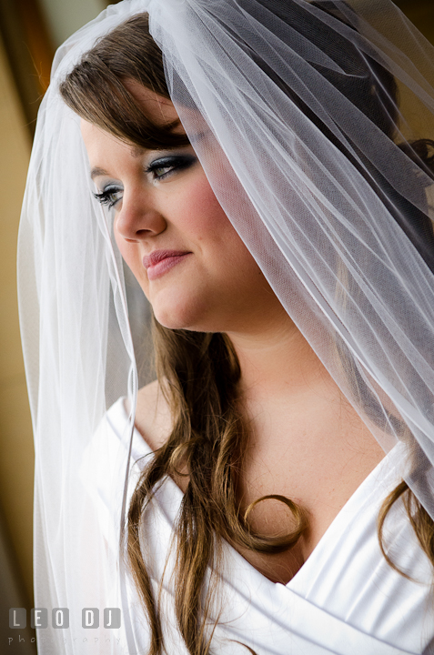 Bride's portrait looking out the window. The Ballroom at The Chesapeake Inn wedding ceremony photos, Chesapeake City, Maryland by photographers of Leo Dj Photography.