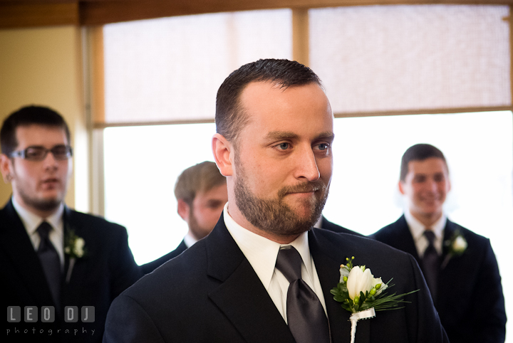Groom smiled seeing Bride the first time in her wedding dress. The Ballroom at The Chesapeake Inn wedding ceremony photos, Chesapeake City, Maryland by photographers of Leo Dj Photography.