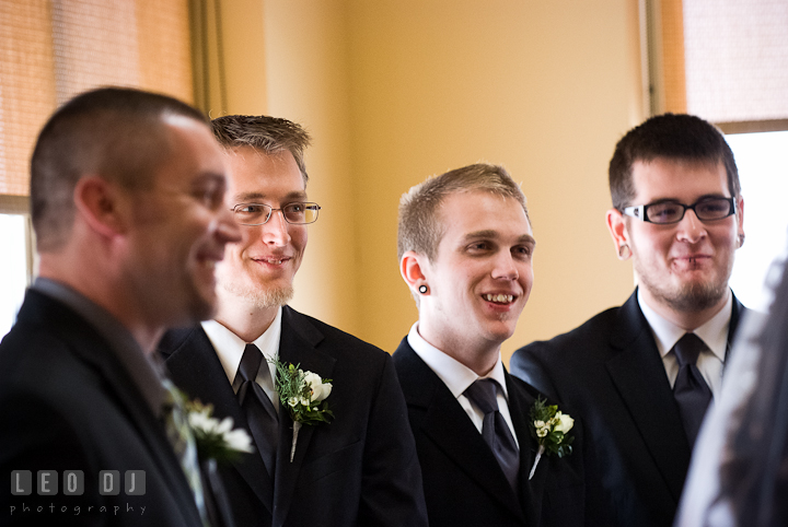 Best man and groomsmen smiling. The Ballroom at The Chesapeake Inn wedding ceremony photos, Chesapeake City, Maryland by photographers of Leo Dj Photography.