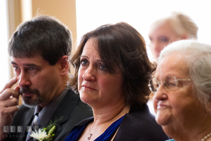 Mother of Groom shed tear during the ceremony. The Ballroom at The Chesapeake Inn wedding ceremony photos, Chesapeake City, Maryland by photographers of Leo Dj Photography.