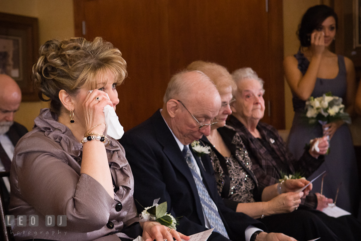 Mother of Bride wiping of tears from her eyes. The Ballroom at The Chesapeake Inn wedding ceremony photos, Chesapeake City, Maryland by photographers of Leo Dj Photography.