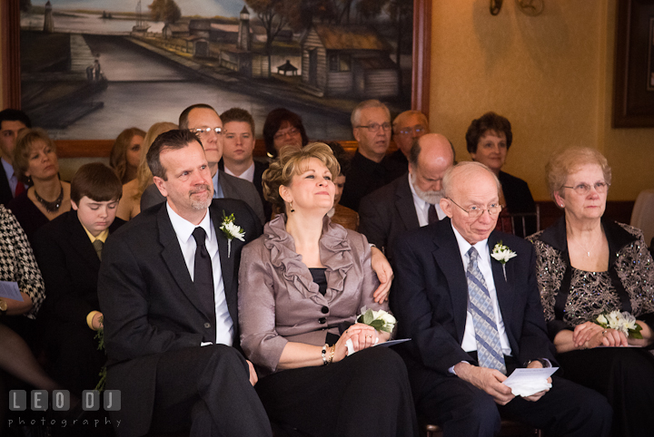 Mother, father, grandparents and guests smiling. The Ballroom at The Chesapeake Inn wedding ceremony photos, Chesapeake City, Maryland by photographers of Leo Dj Photography.