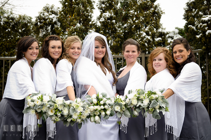 Bride, Matron of Honor, and Bridesmaids showing their bouquets. The Ballroom at The Chesapeake Inn wedding ceremony photos, Chesapeake City, Maryland by photographers of Leo Dj Photography.