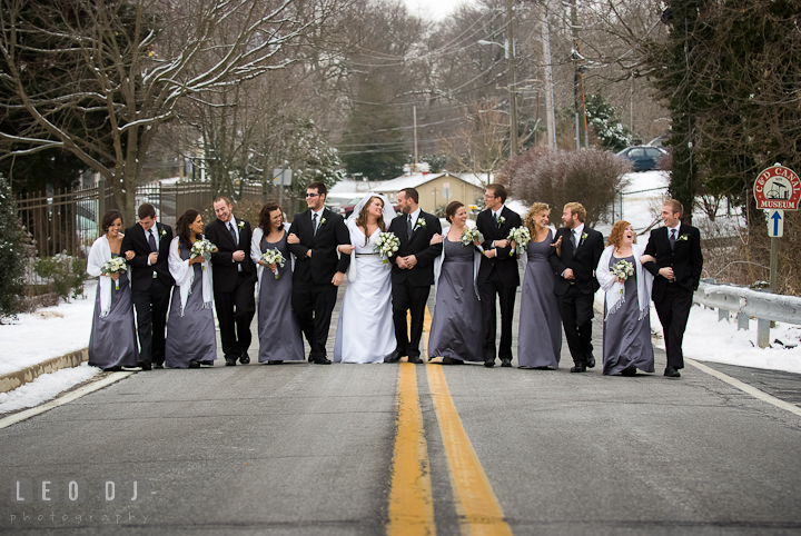 Bride, Groom and the Bridal Party walking together on the road. The Ballroom at The Chesapeake Inn wedding ceremony photos, Chesapeake City, Maryland by photographers of Leo Dj Photography.