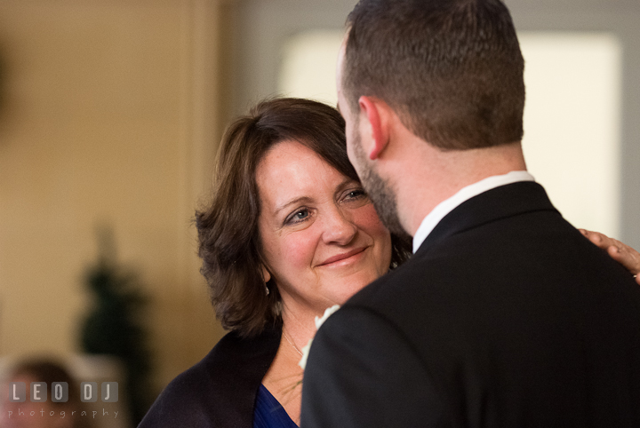 Mother of the Bride smiling while dancing with son. The Ballroom at The Chesapeake Inn wedding reception photos, Chesapeake City, Maryland by photographers of Leo Dj Photography.