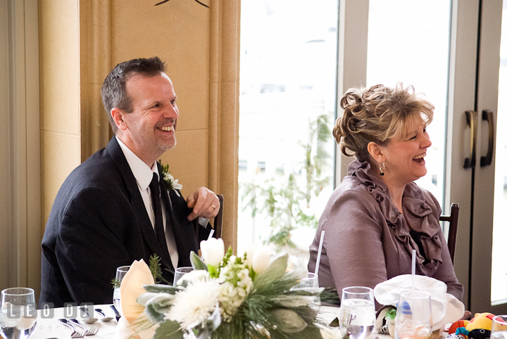 Father and Mother of Bride laughing listening to speech. The Ballroom at The Chesapeake Inn wedding reception photos, Chesapeake City, Maryland by photographers of Leo Dj Photography.