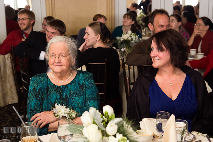 Grandmother and Mother of Groom smiling listening to speech. The Ballroom at The Chesapeake Inn wedding reception photos, Chesapeake City, Maryland by photographers of Leo Dj Photography.