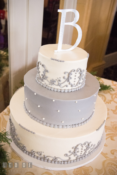 Winter color themed cake with metal letter topper. The Ballroom at The Chesapeake Inn wedding reception photos, Chesapeake City, Maryland by photographers of Leo Dj Photography.