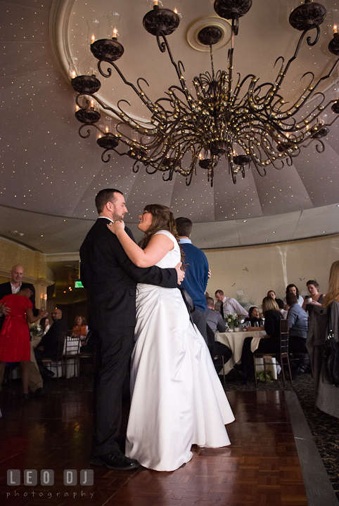 Bride and Groom dancing under the dome and the beautiful chandelier. The Ballroom at The Chesapeake Inn wedding reception photos, Chesapeake City, Maryland by photographers of Leo Dj Photography.