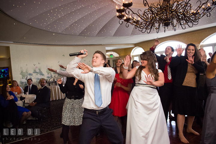 Bride and guests dancing to Crank That by Soulja Boy. The Ballroom at The Chesapeake Inn wedding reception photos, Chesapeake City, Maryland by photographers of Leo Dj Photography.