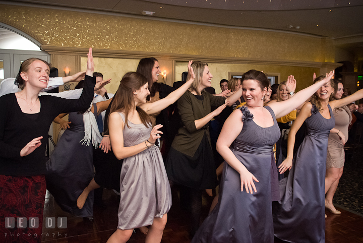 Matron of Honor, bridesmaids, and guests doing the Superman move. The Ballroom at The Chesapeake Inn wedding reception photos, Chesapeake City, Maryland by photographers of Leo Dj Photography.