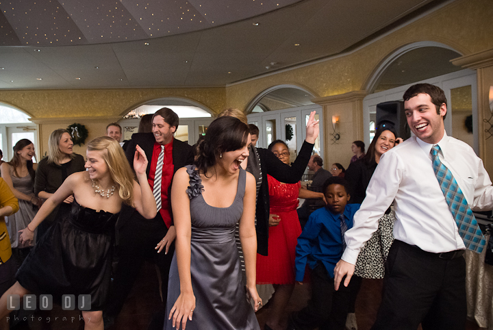 Bridesmaid and guests laughing having fun dancing at the party. The Ballroom at The Chesapeake Inn wedding reception photos, Chesapeake City, Maryland by photographers of Leo Dj Photography.