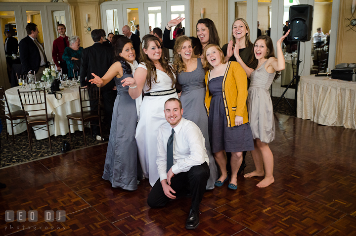 Bride posing with college alumni friends. The Ballroom at The Chesapeake Inn wedding reception photos, Chesapeake City, Maryland by photographers of Leo Dj Photography.