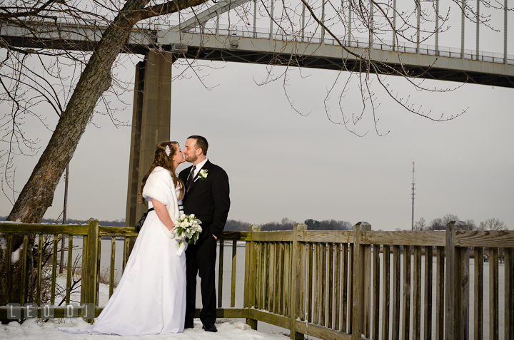Bride and Groom almost kissed with bridge in the background. The Ballroom at The Chesapeake Inn wedding reception photos, Chesapeake City, Maryland by photographers of Leo Dj Photography.