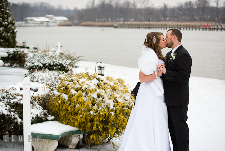 Bride and Groom kissing in a wintry backdrop. The Ballroom at The Chesapeake Inn wedding reception photos, Chesapeake City, Maryland by photographers of Leo Dj Photography.