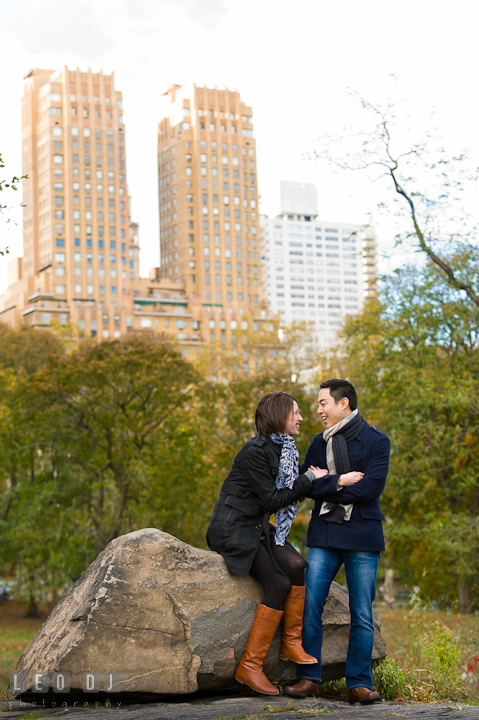 Engaged couple chatting and laughing together at Central Park. Pre-wedding engagement photo session at New York City, NY, by wedding photographers of Leo Dj Photography. http://leodjphoto.com
