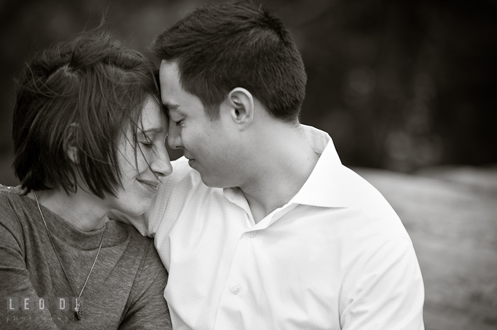Engaged girl cuddling with her fiancé at Central Park. Pre-wedding engagement photo session at New York City, NY, by wedding photographers of Leo Dj Photography. http://leodjphoto.com