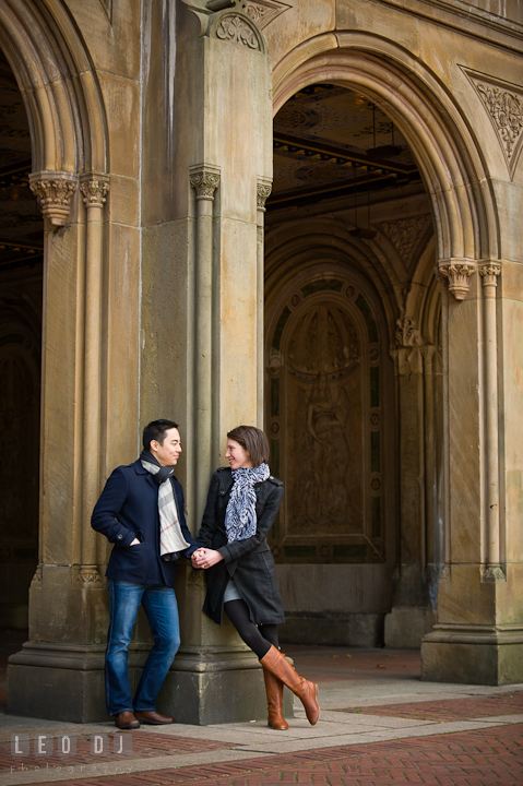 Engaged couple holding hands at Bethesda Terrace, Central Park. Pre-wedding engagement photo session at New York City, NY, by wedding photographers of Leo Dj Photography. http://leodjphoto.com