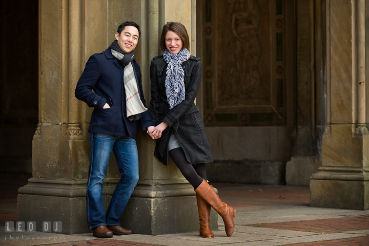 Engaged couple posing and smiling at Bethesda Terrace, Central Park. Pre-wedding engagement photo session at New York City, NY, by wedding photographers of Leo Dj Photography. http://leodjphoto.com