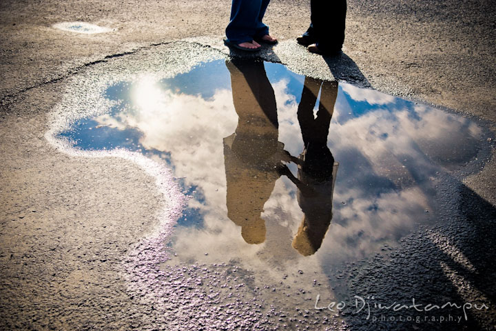 Reflection of engaged couple holding hands on a puddle. Stevensville, Kent Island, Maryland, Pre-Wedding Engagement Photographer, Leo Dj Photography