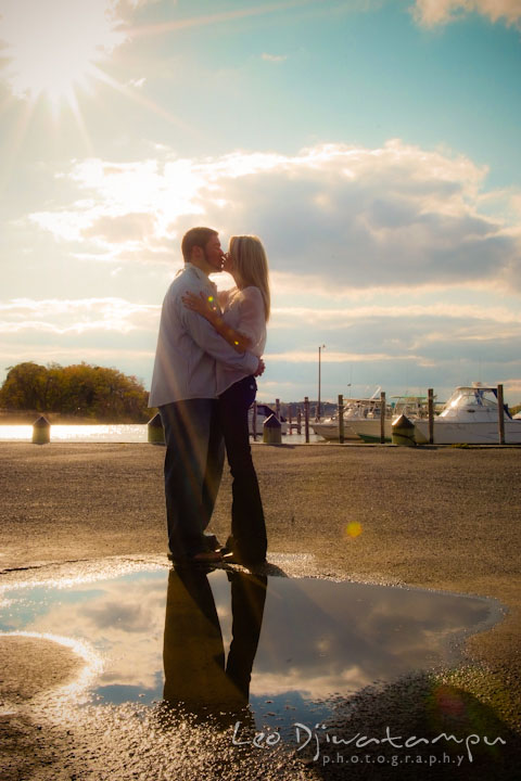 Engaged couple kissing with the sun and awesome clouds behind them. Stevensville, Kent Island, Maryland, Pre-Wedding Engagement Photographer, Leo Dj Photography
