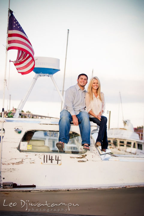 Engaged guy and girl couple sitting on top of a crabbing boat. Stevensville, Kent Island, Maryland, Pre-Wedding Engagement Photographer, Leo Dj Photography