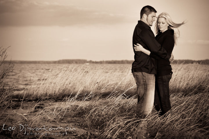 Engaged couple at a beach, hugging. Stevensville, Kent Island, Maryland, Pre-Wedding Engagement Photographer, Leo Dj Photography