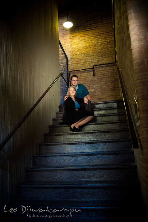 Engaged guy and his fiancée posing on stairs. Ellicott City and Patapsco Park Maryland pre-wedding engagement photo session by photographers of Leo Dj Photography