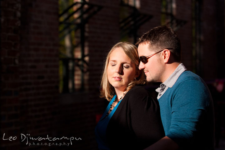 Engaged guy cuddling his fiancée. Ellicott City and Patapsco Park Maryland pre-wedding engagement photo session by photographers of Leo Dj Photography