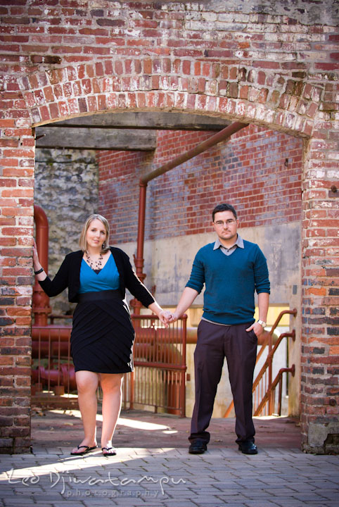 Engaged couple standing under an arch doorway. Ellicott City and Patapsco Park Maryland pre-wedding engagement photo session by photographers of Leo Dj Photography