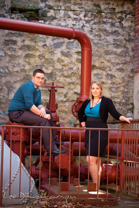 Engaged girl and her fiancé posed by pipe structures. Ellicott City and Patapsco Park Maryland pre-wedding engagement photo session by photographers of Leo Dj Photography