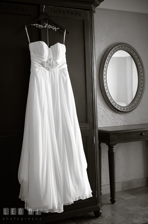 Wedding dress hung by a wardrobe. Cruise ship destination wedding ceremony photos, Hotel Melia Cozumel Mexico by photographers of Leo Dj Photography.