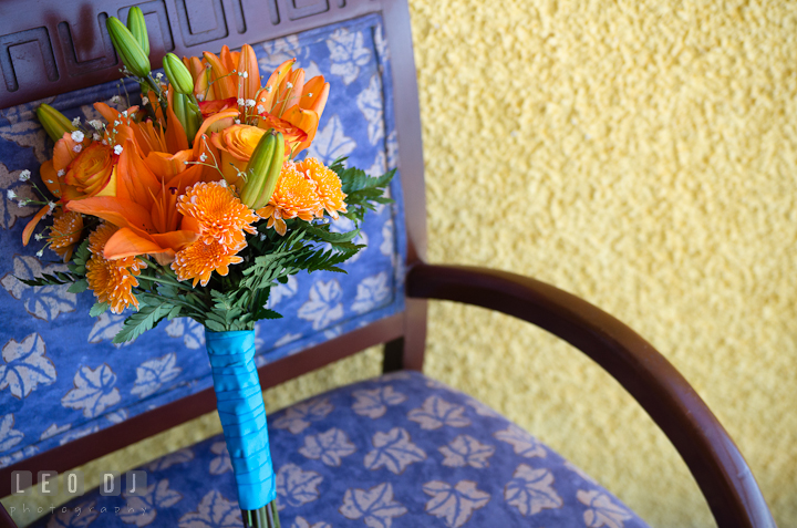 Orange flower bouquet. Cruise ship destination wedding ceremony photos, Hotel Melia Cozumel Mexico by photographers of Leo Dj Photography.
