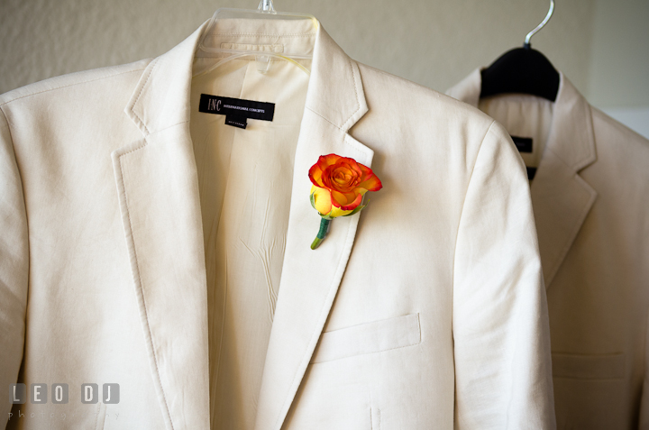 Groom and Best Man's jacket with orange flower boutonniere. Cruise ship destination wedding ceremony photos, Hotel Melia Cozumel Mexico by photographers of Leo Dj Photography.